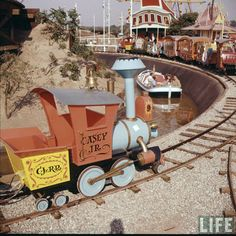 Disneyland opening day 1955 - Casey Jr. Railroad and Storybook Land Canal Boats. From Life Magazine, photos by Allan Grant and Loomis Dean. Color corrected by United Style.