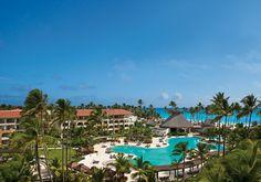 Now Larimar features expansive pool areas with lush surroundings and lounge chairs.