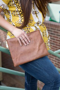 Brown leather hand clutch with magnetic snap closure by SLHandbags, $25.00