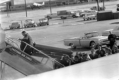 President John F. Kennedy's Casket Loaded on to Air Force One.
