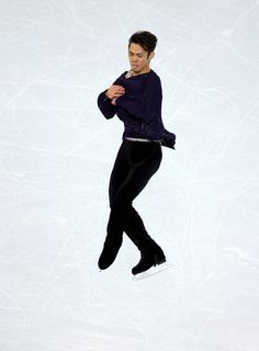 Daisuke Takahashi Photos Photos - Daisuke Takahashi of Japan performs during the Figure Skating Men's Free Skating on day seven of the Sochi 2014 Winter Olympics at Iceberg Skating Palace on February 14, 2014 in Sochi, Russia. - Winter Olympics: Figure Skating