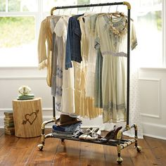The Emily + Meritt Wardrobe Rack from PBteen. Hang your favorite dresses, shirts, scarves, and more from this rolling rack, inspired by a vintage find. The space below is perfect for shoes, hats, and smaller items. This rack would be so useful for my girls and it's pretty too!