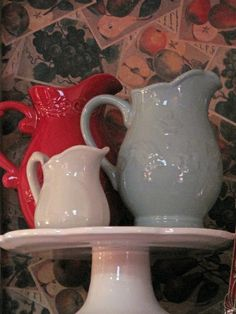 red, white and blue pitchers on stand