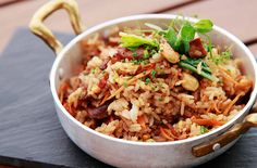 "Spanish ""fried rice"" (with cashews, shredded carrots, marrow-stem kale, chunks of spicy chorizo, roasted chicken and fresh shrimp.)"
