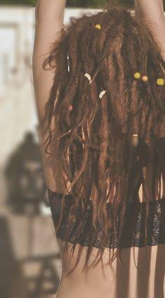 Dreadlocks, natural look with decorations.