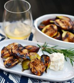 [ Recipe: Grilled Figs with Honeyed Mascarpone ] Made with: plump black figs, dark honey (buckwheat or pine), fresh rosemary, mascarpone cheese, rum, and lemon. ~ from The Kitchn