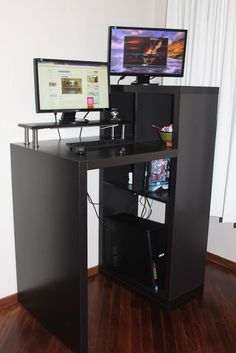 Expedit Workstation to Small Form Standing Desk.  IkeaHackers! Standing desk created from modifying IKEA furniture.  Brilliant!