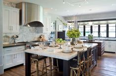 It's common for the kitchen island to become a table in both traditional and modern homes