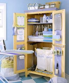 Armoire to Laundry Station Add a decorative touch to a utilitarian laundry room with a freestanding cupboard. Bins organize clothes for washing, and shelves store detergent and other supplies. If folding drying racks or an ironing board won't fit within, either could be mounted on the outside with a simple, sturdy hook.