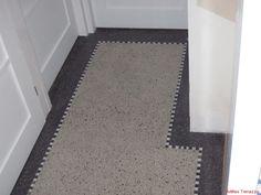 Een mooie, maar kapotte terrazzo vloer in de keuken!