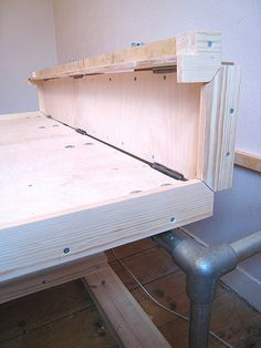 Tricky to do (you can see the bottom one is far better than the top one) - I'll fit clasps across these joints to hold it in this position when you put the bed up against the wall. Build A Murphy Bed, Best Murphy Bed, Fold Up Beds, Office Bed, Spare Room, Folded Up, Tiny House, Entryway Tables, Interior