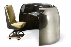 DC-6 Cowling Airplane Desk - The Douglas DC-6 Cowling Desk is the best in her class. Originally formed as housings for Pratt & Whitney engines, these cowlings now make an elegant workstation or bar for your use. Beautifully aged and mirror polished. MotoArt.com