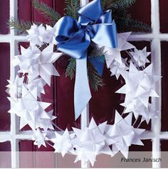 Red, White & Blue for Paper-Star Wreath: Handmade paper stars, glued to a wire wreath, strike a modern pose in a window. This graphic ring will be ready to hang again next year. Christmas Door Decorations, Christmas Bows, Christmas Paper, Holiday Wreaths, Handmade Christmas, Holiday Crafts, Craft Decorations, Winter Wreaths, Spring Wreaths