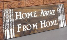"HOME AWAY FROM HOME SIGN/RUSTIC SIGN/COTTAGE SIGN/HOUSEWARMING SIGN THIS WOOD SIGN HAS BEEN STAINED IN A DARK WALNUT STAIN WITH WHITE TEXT AND BIRCH TREES. THE SIGN CAN BE SEALED FOR INDOORS OR OUTDOORS. PLEASE MAKE THE SEALANT SELECTION WHEN PURCHASING. A CLAW TOOTH HANGER COMES INSTALLED. MEASUREMENTS: 11 1/4"" X 30"" 3/4"" THICKNESS CONTACT: kimbercreations@outlook.com SHIPPING: READY TO SHIP WITHIN 3-5 BUSINESS DAYS. THANK YOU FOR VIEWING!"