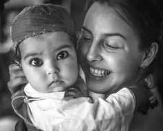 East Meets West Monochrome.  On an overnight train journey in India one of my students hit it off with this cute little Muslim baby. He seemed to really like her and be fascinated by me and my camera.