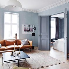 A Norwegian home tour: sitting room with light blue walls and cognac leather sofa. Living Room Grey, Living Room Decor, Living Rooms, Cognac Leather Sofa, Norwegian House, Light Blue Walls, Sofa Design, Home Decor, Shades