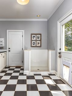 Sliding barn door leading to the mudroom with built-in cubbies, a dog shower and dog door to the fenced yard. Listed in Vienna, Virginia for $1.6M by The Casey Samson Team is a Wall Street Journal Top Team in Northern Virginia