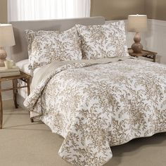 @Overstock - Laura Ashley Bedford Mocha Cotton 3-piece Quilt Set - Dress your bed in elegance with the Laura Ashley Bedford quilt set featuring a floral pattern in a brown and ivory finish. Constructed of 100-percent cotton, this set is available in twin, full/queen and king dimensions.   http://www.overstock.com/Bedding-Bath/Laura-Ashley-Bedford-Mocha-Cotton-3-piece-Quilt-Set/8950175/product.html?CID=214117 $71.99