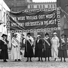 Suffragettes display banners at Washington Mews in Greenwich Village, New York City, circa 1912.