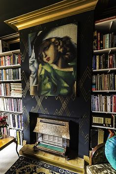 The Digitized Lempicka Print, Brass Firebox, and plentiful Books, make for a Handsomely Bohemian Library.