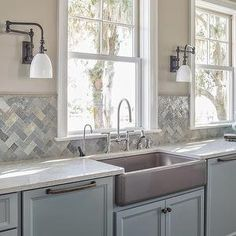 Reu Architects - kitchens - beige paint colors, beige wall paint, no upper cabinets, gray island, gray kitchen island, gray cabinets, gray kitchen cabinets, quartz countertops, cream quartz countertops, stainless steel apron sink, concealed dishwashers, paneled dishwashers, apron sink, swing arm sconces, kitchen wall lights, kitchen sconces, kitchen wall sconces, ann sacks tile, herringbone tiles, herringbone backsplash, herringbone kitchen backsplash, thermador dishwasher, sapphire…