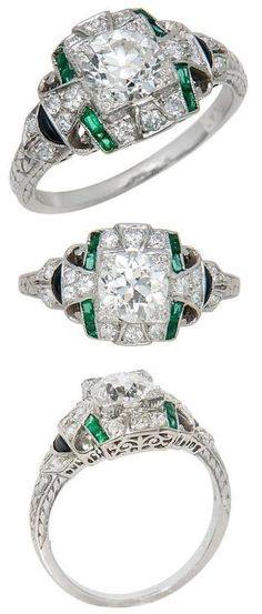 Art Deco platinum, diamond, emerald and onyx engagement ring. 1930's all original Art Deco engagement ring, with a .88 carat center diamond and a mounting set with smaller diamonds, emeralds, and onyx and has engraved designs down the shoulders. Via Diamonds in the Library.