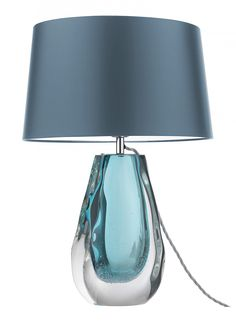 Anya Peacock Table Lamp | Freeblown and hand formed to distort the shape and add interesting silhouettes, this stunning table lamp has an additional decorative detail of small bubbles in the colour drop. Available in Peacock, Olive and Violet.