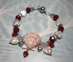 This lady makes some classy jewelry out of seashells she finds on her walks on the gulf coast beaches.