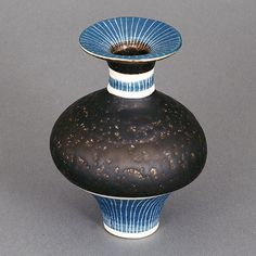 Lucie Rie Small Vase, circa 1970 Porcelain, dark brown manganese glaze, blue bands to the lip, neck and foot with sgrafitto, impressed LR seal