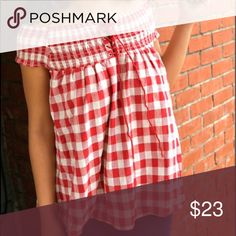 Checkered Charm We love the checkered design, tie-up front, and the off-the-shoulder style with this piece. Pair this top with your favorite pants or shorts for the perfect Spring or Summer look.  Model: 5'2 / Bust 32 / Waist 25 and is wearing a small.  Material: 100% Cotton Tops