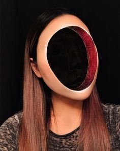Here, see how makeup artist Mimi Choi created a faceless optical illusion look by using just cosmetics. Prepare to be scared!