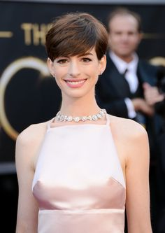 Anne Hathaway, Best Supporting Actress in Les Misérables, born November 12, 1982__Sun in Scorpio, Moon in Libra, Sagittarius rising. I really like her, but what is up with this dress? It's a snooze.