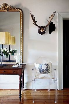 I love the antlers! It looks really cool. I love the mirror too. From: How To Decorate a Blank Wall With Chic Styling on HarpersBazaar.com