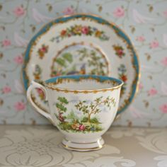 *saucer:  Chelsea Bird/Royal Albert/early 1940s: this teacup and saucer hail from potteries established in 1896 in the north of England. These potteries became known as Royal Albert when chinaware from there became a favourite of Prince Albert (Queen Victoria's husband) in 1904 and was used by the royal family in Buckingham Palace.