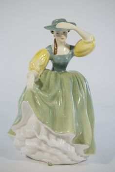 """Royal Doulton Buttercup bone china figurine - HN2309. Highly collectible and in excellent condition! Very nice! Details: - Measures about 7"""" tall. - Made in England. Condition: - Part of our Estate Co"""