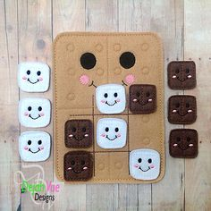 Smores themed felt tic tac toe board available at https://www.etsy.com/shop/SchoolhouseBoutique