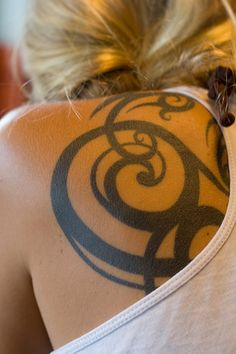 tribal swirl tattoo