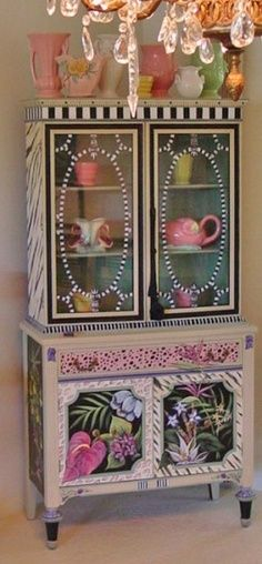 I have a hutch very similar in style!  Oh if i wasn't afraid....I would Love to paint it. Hand Painted Furniture