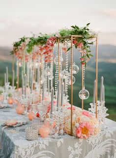 If you find yourself daily dreaming of rom-coms in Italy, then this lavish peach wedding inspiration in the heart of Siena just might stop you in your tracks. With a Tuscan hill view and floating candles along the tablescape, this European vineyard fete i Tall Wedding Centerpieces, Flower Centerpieces, Flower Arrangements, Centerpiece Ideas, Wedding Tables, Coral Wedding Decorations, Wedding Arrangements, Centrepieces, Quinceanera Centerpieces