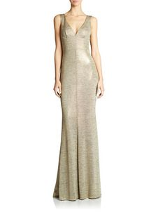 Turn heads in this slinky, metallic gown. Designed with a V-neckline and over  heathered pattern, pair this dress with strappy heels for a sexy, special occasion look.