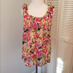 LOFT floral sleeveless top Frilly sleeveless top with floral design. Slight pleating under bodice. Great condition. NO TRADES LOFT Tops