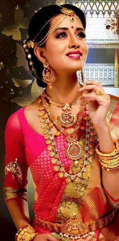 South Indian bride. Gold Indian bridal jewelry.Temple jewelry. Jhumkis.Pink silk kanchipuram sari.Braid with fresh jasmine flowers. Tamil bride. Telugu bride. Kannada bride. Hindu bride. Malayalee bride.Kerala bride.South Indian wedding.  https://www.facebook.com/funnyfinternet/