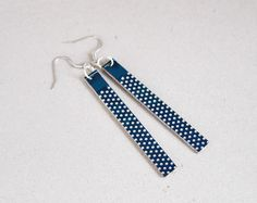 These earrings were made from pieces of circuit board blue color. We find the pieces with cute dots. To finish them we use surgical steel ear wires,