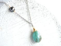 Peruvian opal and Tahitian keshi pearl necklace.
