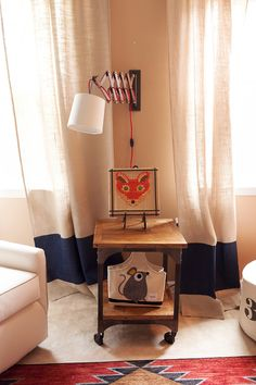 Love this wall lamp in a woodland nursery - fun fox accents!