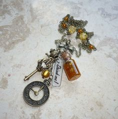 Drink me - Alice in Wonderland charmed bronze necklace with tiny gold bottle, key, clock, teapot charms