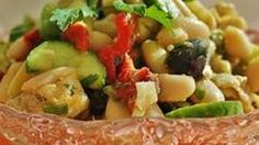 Cannellini beans, artichoke hearts, cucumbers, tomatoes, olives, and plenty of fresh herbs are tossed with a tangy sherry vinaigrette in this refreshing salad.