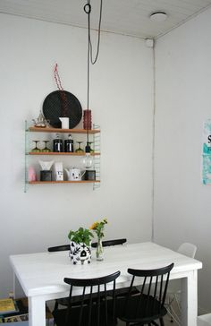 Use CD racks as shelf supports - Saara's Bright & Quirky Helsinki Loft