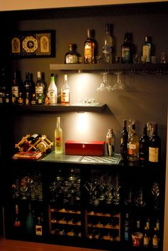 i like this because it includes classic games on display.  you could really have some fun adding a display specifically for games!  50 Stunning Home Bar Designs
