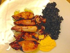 So many types of Squid in Spain with rice cooked in Squids ink — in Barcelona, Catalonia.